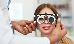 What is the difference between an optical dispenser and an optometrist?